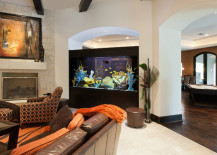 Large aquarium separating rooms 217x155 8 Extremely Interesting Places to Put an Aquarium in Your Home