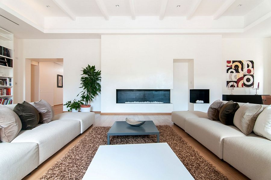 Large couches create a cozy living room that is both modern and classy