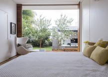 Large-glass-door-connects-the-bedroom-with-the-wooden-deck-217x155