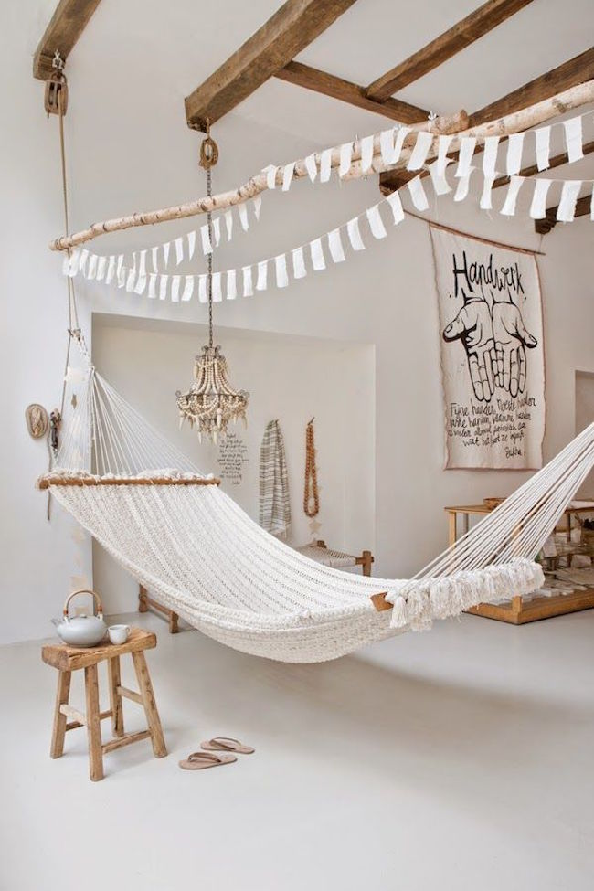 Large hammock in white room with wood accents