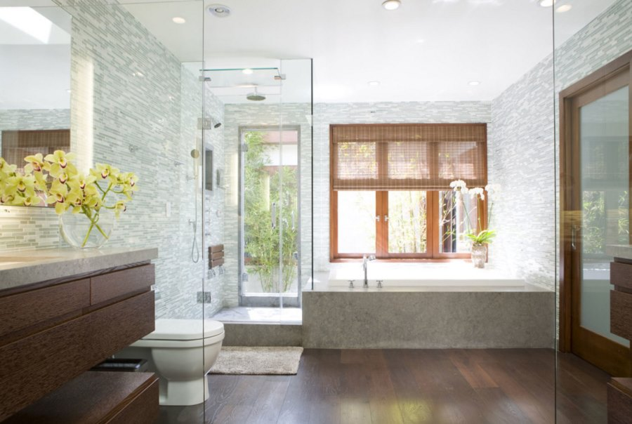 Large vase of flowers in an upscale modern bathroom