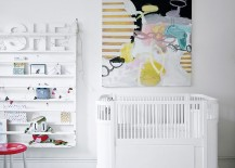 Large wall art adds color to the all-white nursery
