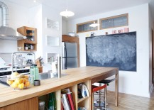 Large-wooden-island-with-ample-open-shelving-for-the-industrial-kitchen-217x155