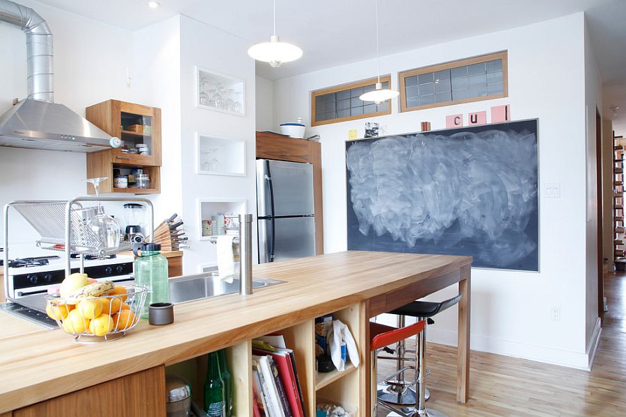 Large wooden island with ample open shelving for the industrial kitchen [Design: Esther Hershcovich]