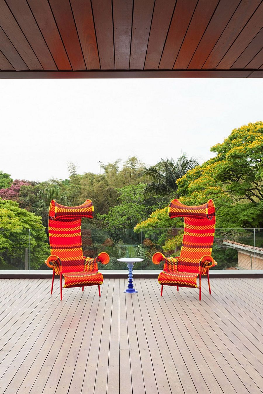 Lavish wooden deck of the Brazilian home with unabated view of canopy outside