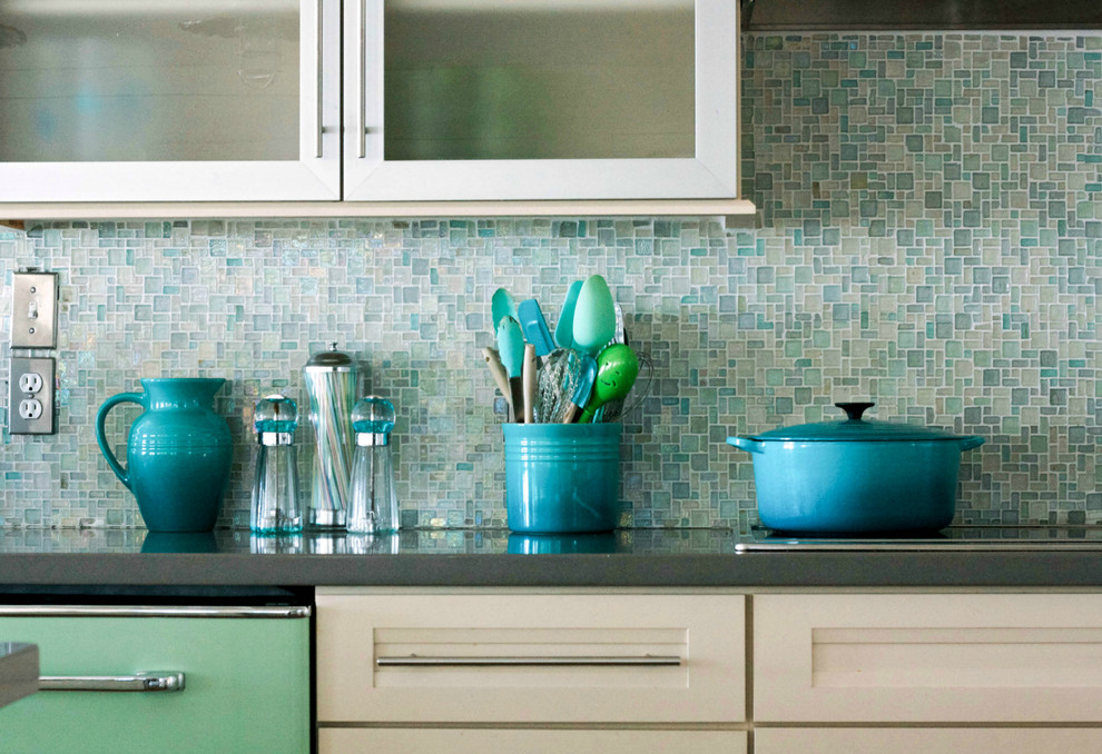 light blue and turquoise mosaic tile kitchen backsplash