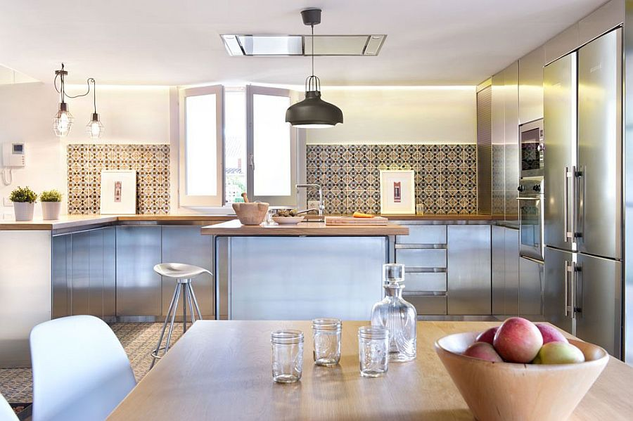 Light tube brings natural ventilation to the lower level kitchen