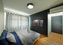 Lighting adds to the appeal of the chalk board in the contemporary bedroom