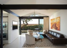 Living area of the revamped LA home connected with the extreior landscape through glass doors