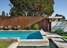Lovely backyard pool that overflows into the reflection pool