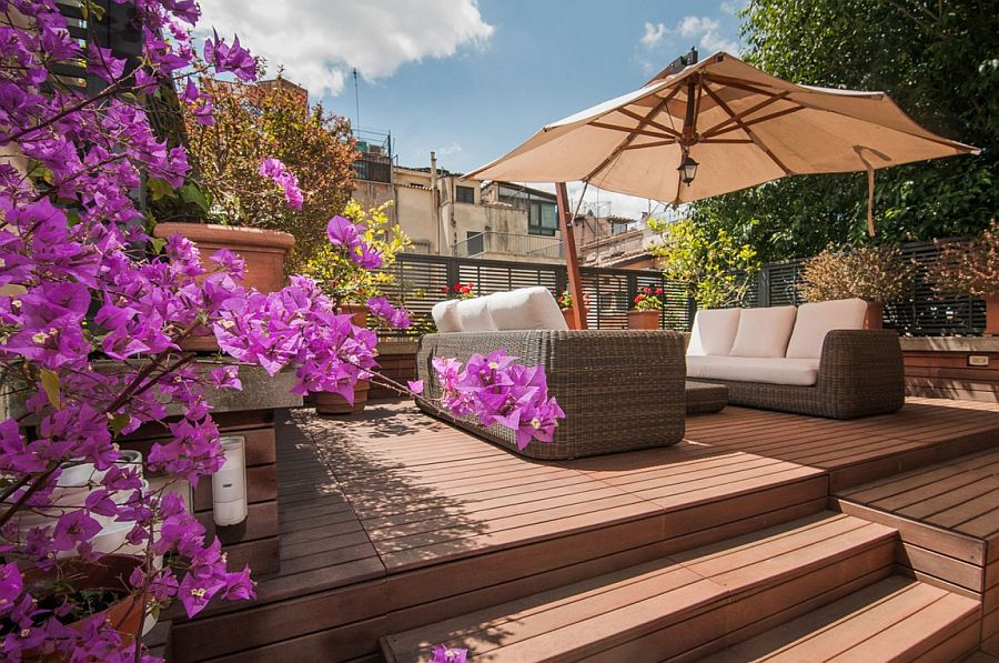 Lovely wooden deck of apartment in rome with shaded lounge