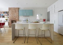 Lower-level-living-area-witj-kitchen-dining-and-brick-wall-fireplace-217x155