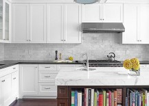 Marble-top-kitchen-island-offers-ample-space-for-your-kitchen-cookbooks-217x155
