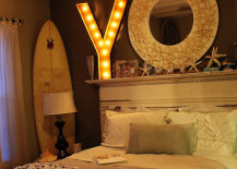 Marquee letter placed over the bed in a bedroom