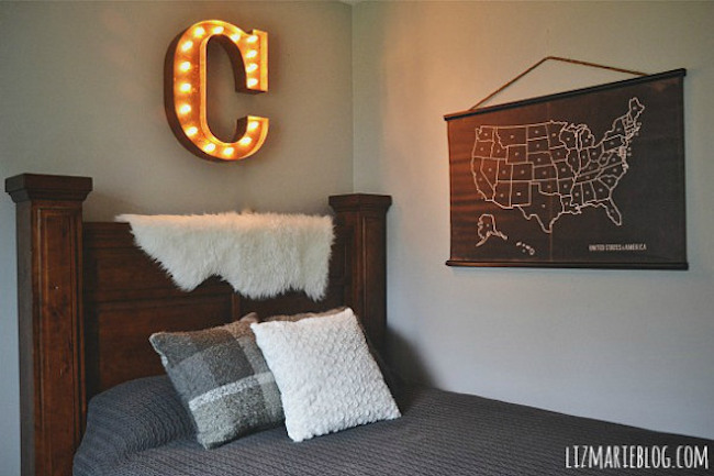 Marquee letter used as wall art above bed headboard