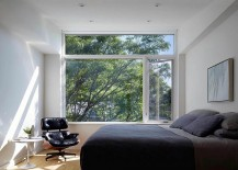 Master-bedroom-in-gray-and-white-with-large-window-and-comfy-Eames-Lounger-217x155