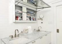 Medicine cabinet with an upward lifting door