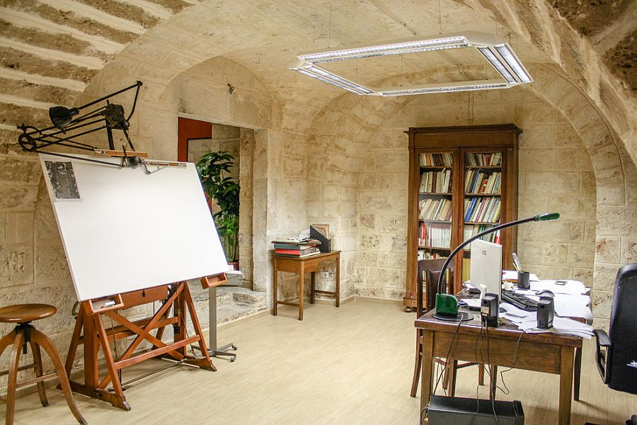 Mediterranean home office with stone walls [Design: Carlo Alberto Amodio Ingegnere]