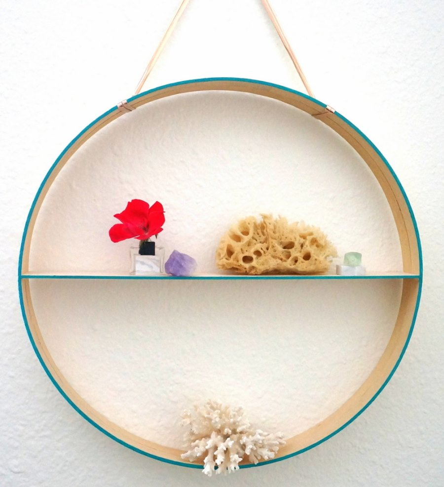Minimalist styling on a round hanging shelf