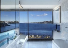 Modern bathroom with a rocky sea view