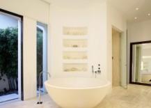 Modern bathroom with a round tub