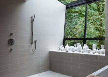 Modern bathroom with a vase collection and a view of the trees