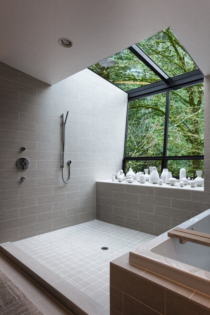 Modern bathroom with a vase collection and a view of the trees  Spectacular Bathroom Design with a View Modern bathroom with a vase collection and a view of the trees