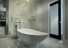 Modern bathrooom with a rain glass door