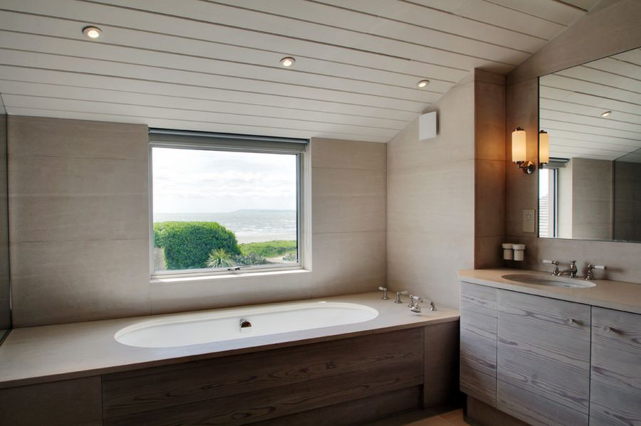 Modern bathtub with a view of the beach