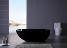 Modern black bathtub in a grey powder room