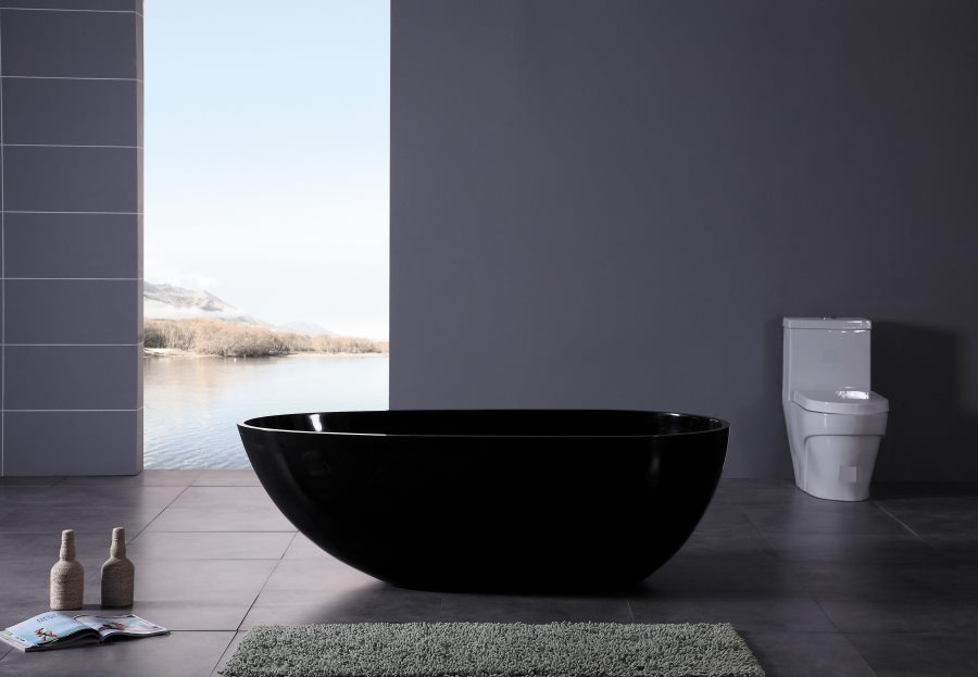 Modern black bathtub in a grey powder room