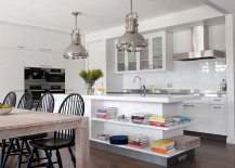 Modern kitchen with industrial style lighting and white island with open shelves 217x155 Trendy Display: 50 Kitchen Islands with Open Shelving