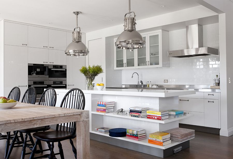 Modern kitchen with industrial style lighting and white island with open shelves [Design: Diane Bergeron Interiors]