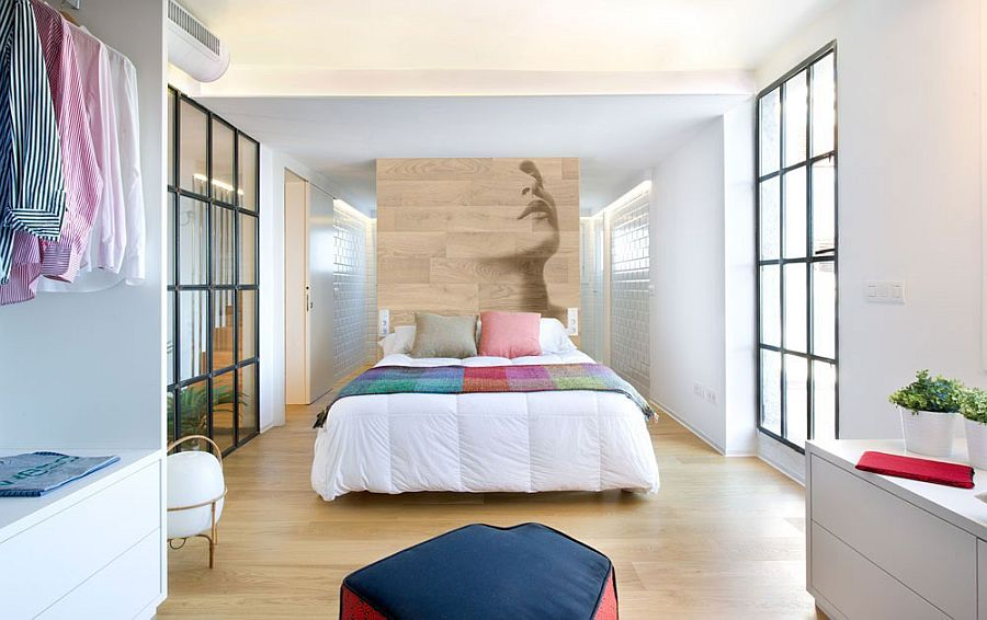 Modern minimal bedroom with a wooden accent wall