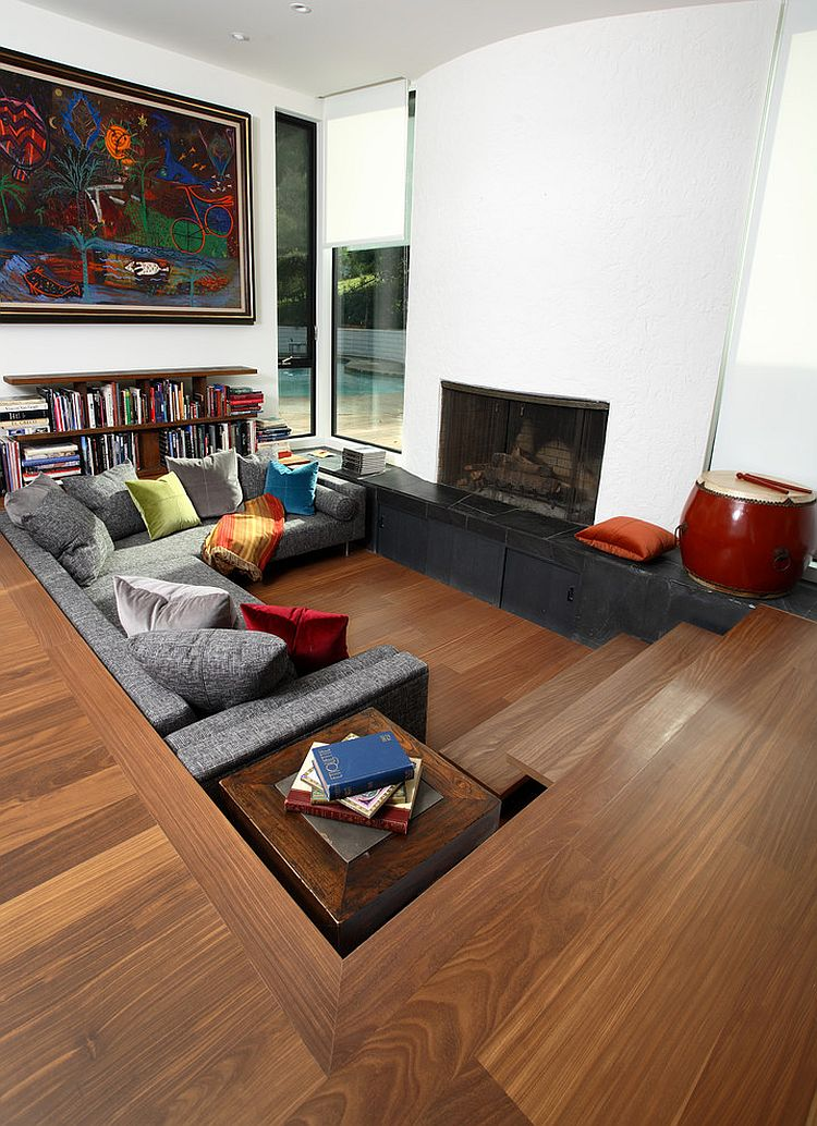 Modern sunken living room with pops of color