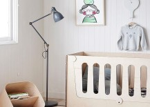 Monochromatic nursery with floor lamp and a contemporary crib
