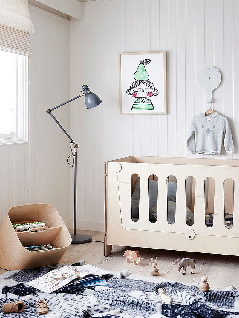 Monochromatic nursery with floor lamp and a contemporary crib [Design: Plyroom]