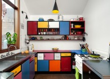 Multi colored shelves create a fun and dynamic kitchen 217x155 50 Trendy Eclectic Kitchens That Serve Up Personalized Style