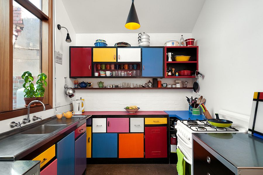 Multi-colored shelves create a fun and dynamic kitchen [Design: Ande Bunbury Architects]