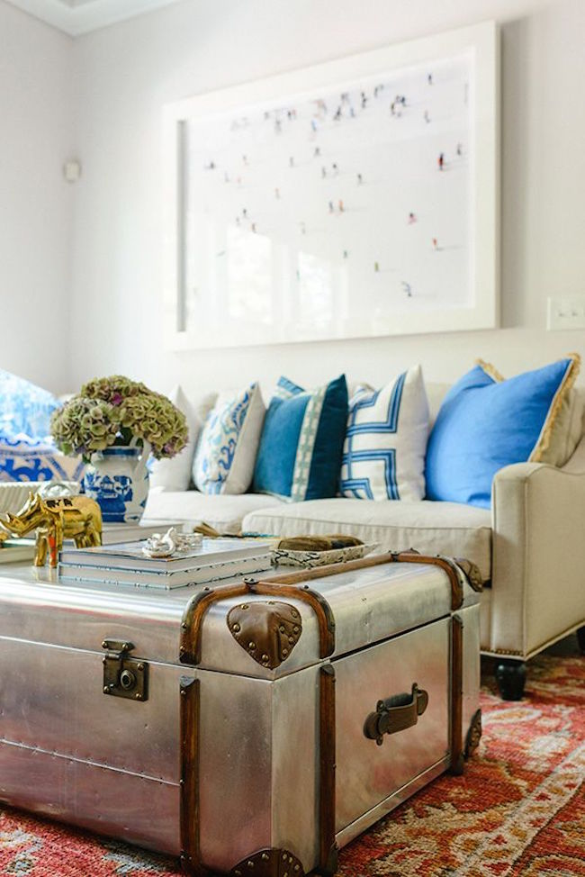 Old tin or metal trunk brings some shine to a living room