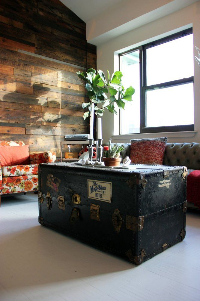 Old trunk complete with stickers used as coffee table