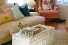 Old worn white trunk coffee table in living room  16 Old Trunks Turned Coffee Tables That Bring Extra Storage and Character Old worn white trunk coffee table in living room 270x180