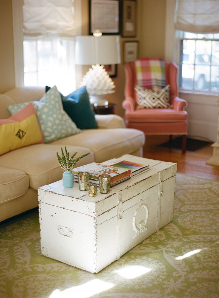 Old worn white/shabby chic trunk coffee table in living room