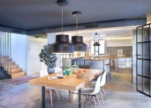 Open design plan creates a flowing interaction between kitchen and dining space
