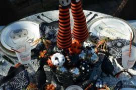 Outdoor Halloween table setting with witch's legs centerpeice