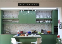 Painted cabinets in Fired Earth Zangar Green in the small eclectic kitchen