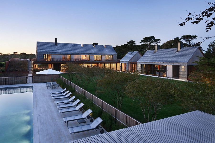 Panoramic view of the Piersons Way Residence with a large garden Gabled Potato Barns Inspire Modern East Hampton Family Home