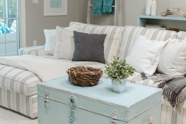 Pastel blue trunk coffee table in living room  16 Old Trunks Turned Coffee Tables That Bring Extra Storage and Character Pastel blue trunk coffee table in living room 270x180