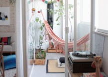 Pink hammock in a sunroom