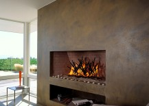 Plastered wall with sleek, contemporary fireplace for the beach style living room